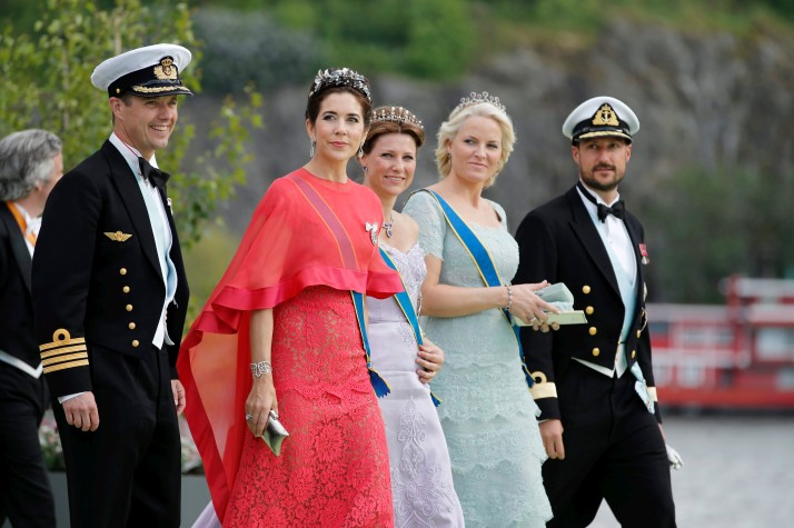 Denmark's Crown Prince Frederik and Crown Princess Mary walk with Princess Martha Louise, Crown Princess Mette-Marit and Crown Prince Haakon of Norway after the wedding ceremony of Sweden's Princess Madeleine and Christopher O'Neill in Stockholm